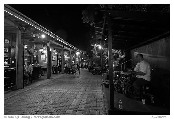 Musicians and restaurant at night, Mallory Square. Key West, Florida, USA (black and white)