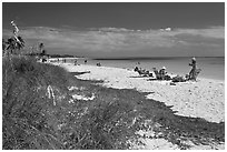 Beachgoers, Sandspur Beach, Bahia Honda State Park. The Keys, Florida, USA (black and white)
