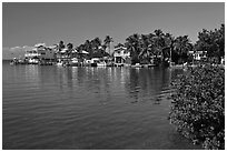 Conch cottages lining edge of Florida Bay, Conch Key. The Keys, Florida, USA ( black and white)