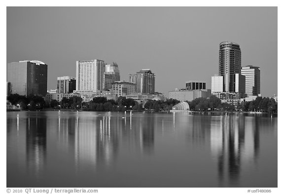 Skyline at dawn from lake Eola. Orlando, Florida, USA (black and white)