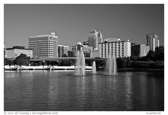 Fountains and morning skyline from Lake Lucerne. Orlando, Florida, USA (black and white)