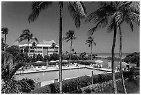 Beachside resort seen through screen, Sanibel Island. Florida, USA (black and white)