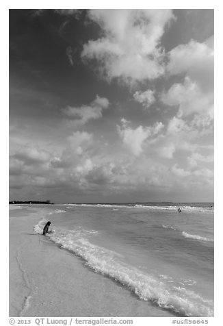 Woman and wave, Fort De Soto beach. Florida, USA (black and white)