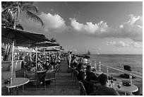 Waiting for sunset with drink in hand on Mallory Square. Key West, Florida, USA (black and white)