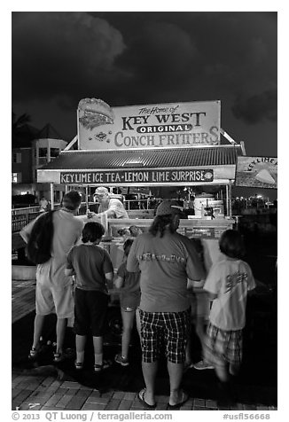 Key lime and conch fritters food stand at night. Key West, Florida, USA (black and white)