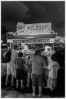 Key lime and conch fritters food stand at night. Key West, Florida, USA ( black and white)