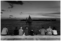 Tourists watching ocean after sunset, Mallory Square. Key West, Florida, USA (black and white)