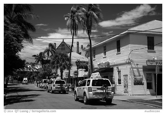 Street with pink cabs. Key West, Florida, USA (black and white)