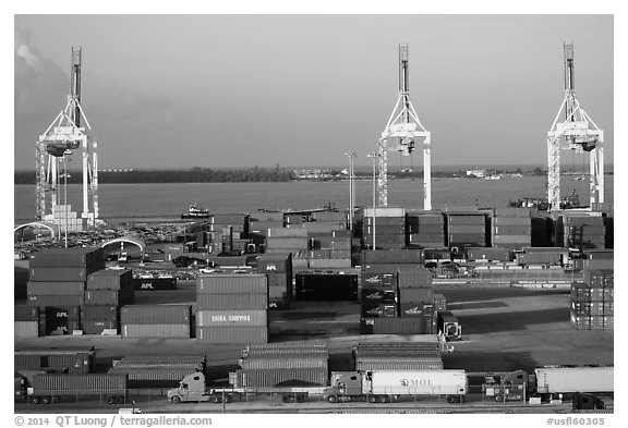 Port with trucks, containers and cranes. Florida, USA (black and white)