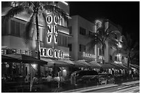 Art Deco hotels colorfully illuminated and traffic light trails, South Beach, Miami Beach. Florida, USA ( black and white)