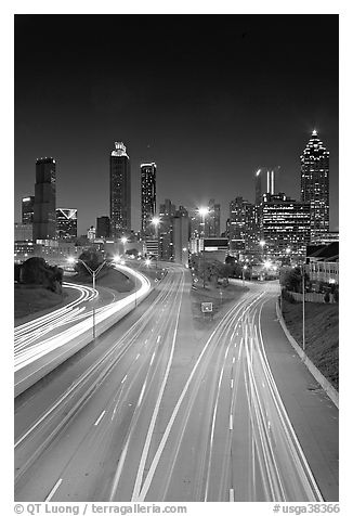 Highway and Atlanta skyline at night. Atlanta, Georgia, USA