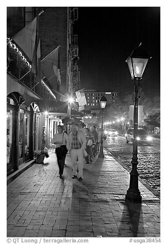 People on sidewalk of River Street by night. Savannah, Georgia, USA (black and white)