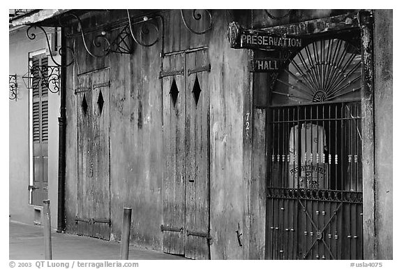 The worned out facade of the Preservation Hall, where some of the best classical jazz can be heard, French Quarter. New Orleans, Louisiana, USA (black and white)