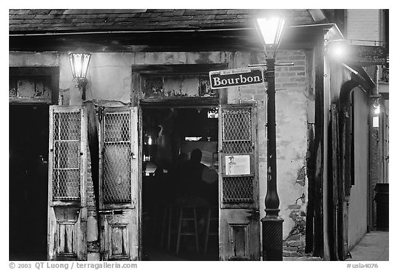 Cafe on Bourbon street at night, French Quarter. New Orleans, Louisiana, USA (black and white)