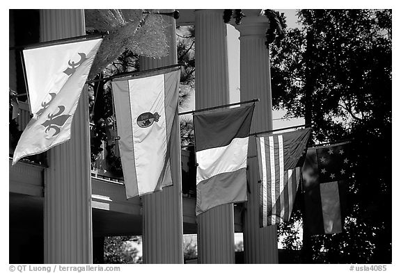 Facade with the four historic flags which have been flown over Louisiana. Louisiana, USA (black and white)