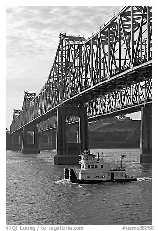 Tugboat under brige on Mississippi River. Natchez, Mississippi, USA (black and white)