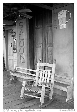 Rocking chair on saloon porch, Natchez under-the-hill. Natchez, Mississippi, USA (black and white)