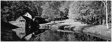 Mill and pond in autumn. Virginia, USA (Panoramic black and white)
