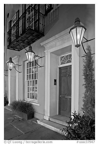 House facade with gas lamps. Charleston, South Carolina, USA (black and white)