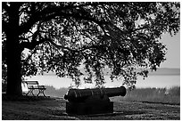 Cannon, and bench overlooking Beaufort Bay at sunrise. Beaufort, South Carolina, USA (black and white)