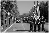Marines carrying flag during parade. Beaufort, South Carolina, USA (black and white)