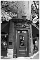 Corner entrance in brick building, Hard Rock Cafe. Nashville, Tennessee, USA (black and white)