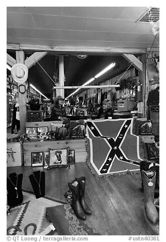 Boots and confederate flag in store. Nashville, Tennessee, USA (black and white)