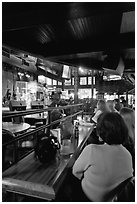 Patrons listen to musical performance in Beale Street bar. Memphis, Tennessee, USA ( black and white)
