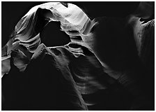 Sandstone walls sculpted by fast moving water, Upper Antelope Canyon. Arizona, USA ( black and white)