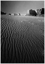 Ripples on sand dunes and mesas, late afternoon. Monument Valley Tribal Park, Navajo Nation, Arizona and Utah, USA ( black and white)