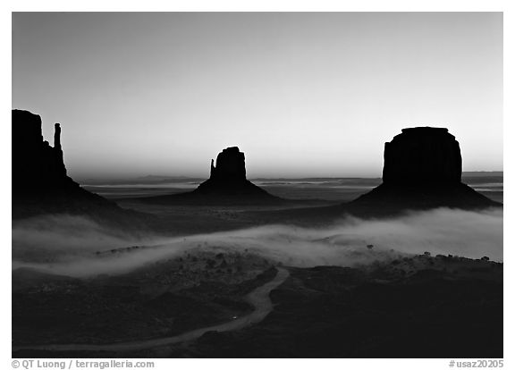 Mittens and fog, sunrise. Monument Valley Tribal Park, Navajo Nation, Arizona and Utah, USA (black and white)