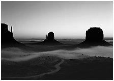 Mittens and fog, sunrise. Monument Valley Tribal Park, Navajo Nation, Arizona and Utah, USA ( black and white)