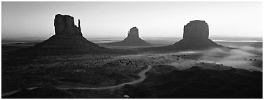 Monument Valley landscape at sunrise. Monument Valley Tribal Park, Navajo Nation, Arizona and Utah, USA (Panoramic black and white)