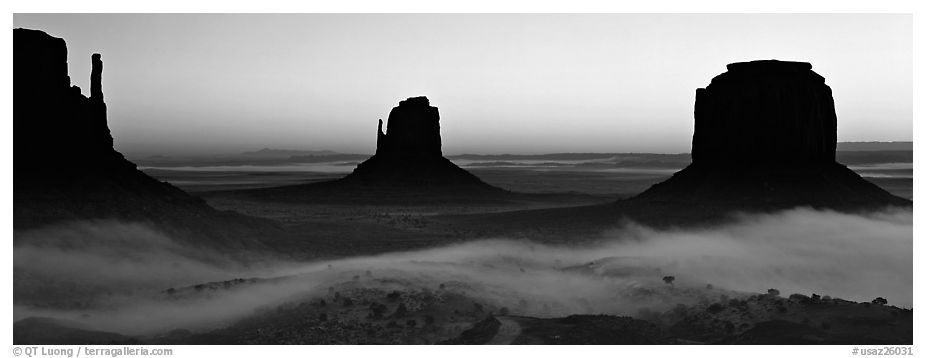 Panoramic black and white picture photo monument valley mittens at sunrise with fog monument valley tribal park navajo nation arizona and utah usa