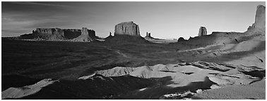 Monument Valley late afternoon scenery with shadows. Monument Valley Tribal Park, Navajo Nation, Arizona and Utah, USA (Panoramic black and white)