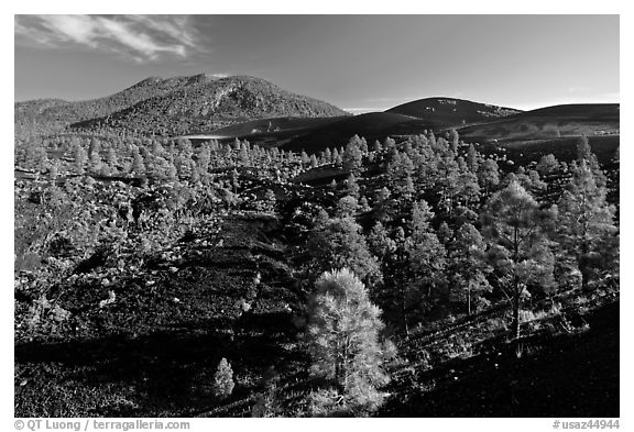 Volcanic hills covered with black lava and cinder, Sunset Crater Volcano National Monument. Arizona, USA (black and white)