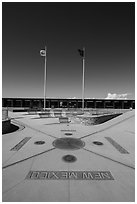 Disks, seals, and flags. Four Corners Monument, Arizona, USA (black and white)