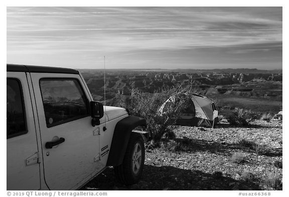 Jeep and tent on Canyon Rim, Twin Point. Parashant National Monument, Arizona, USA (black and white)