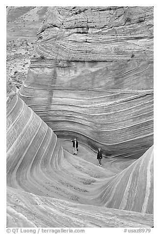 Hikers at the bottom of the Wave. Coyote Buttes, Vermilion cliffs National Monument, Arizona, USA (black and white)