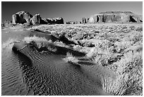 Sand dune and mesas, late afternoon. Monument Valley Tribal Park, Navajo Nation, Arizona and Utah, USA ( black and white)
