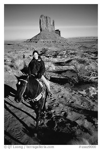 Horseback riding. Monument Valley Tribal Park, Navajo Nation, Arizona and Utah, USA (black and white)