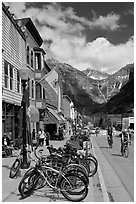 Mountain bikes parked on main street sidewalk. Telluride, Colorado, USA ( black and white)