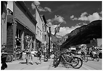 Children walking on main street past mountain bikes. Telluride, Colorado, USA ( black and white)