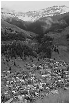 Town, waterfall, and snowy mountains in spring. Telluride, Colorado, USA ( black and white)