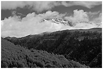 Snowy Mt Wilson emerging from clouds in the spring. Colorado, USA (black and white)