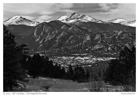 View of town nested below Rocky Mountains, Estes Park. Colorado, USA (black and white)