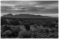 Pueblo and Sleeping Ute Mountain, sunrise. Hovenweep National Monument, Colorado, USA ( black and white)