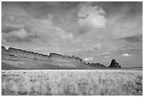 Serrated volcanic ridge leading to Shiprock. Shiprock, New Mexico, USA ( black and white)
