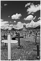 Wooden crosses and old adobe church. Taos, New Mexico, USA (black and white)
