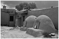 Traditional pueblo ovens. Taos, New Mexico, USA ( black and white)